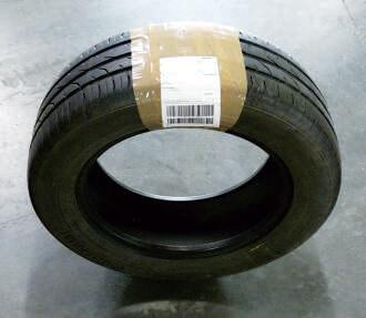 prawidłowo zapakowana opona DHL